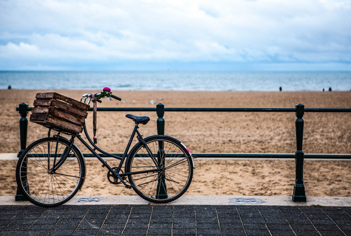Old style bicycle with basket on coast of the North Sea in The Hague, Netherlands shutterstock_354207179-2