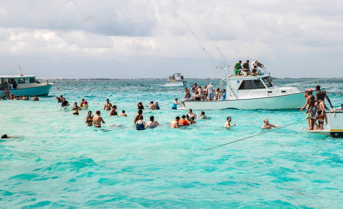 People enjoying Stingray City at Grand Cayman