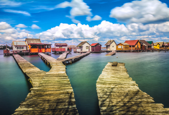 Small fishing cottages on Bokod lake in Hungary shutterstock_267039440-2