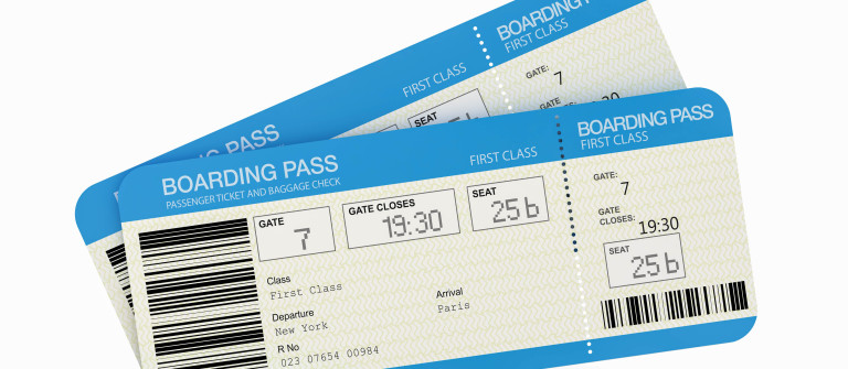Two airline boarding pass tickets isolated on white shutterstock_93760531-2