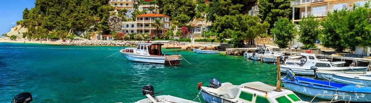 Luxury homes and fishing boats in harbor,Brela,Dalmatia,Croatia