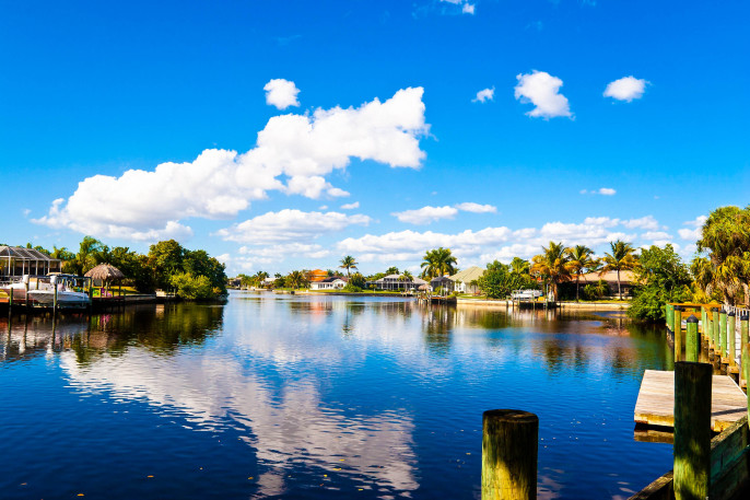 Beautiful Florida Canal with Homes and Boats Cape Coral iStock_000078671915_Large-2