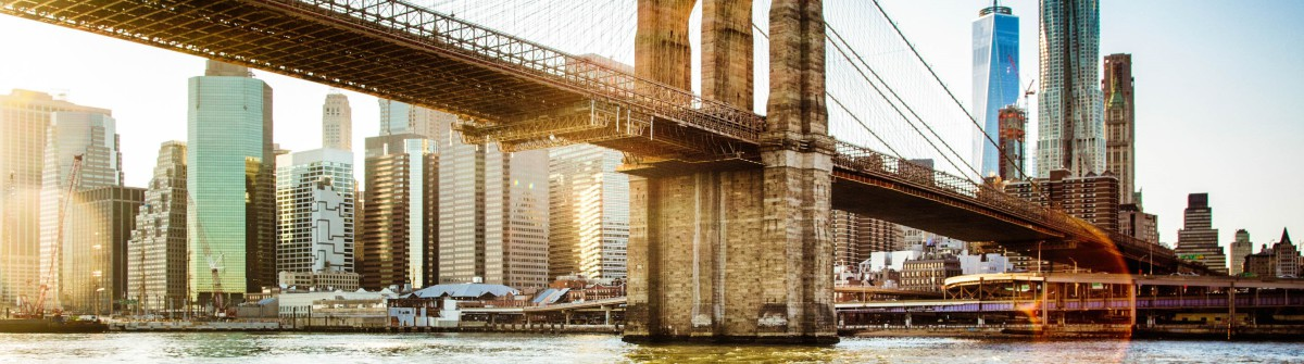 Brooklyn bridge from East river sunset with flare