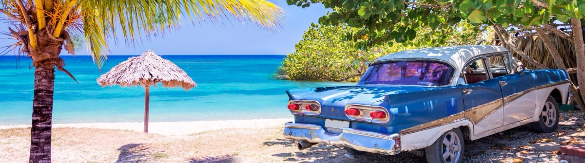 Vintage american oldtimer car parked on a beach in Cuba