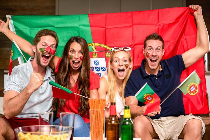 four enthusiastic Portuguese soccer fans