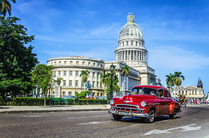 Old classic American maroon car rides in front of the Capito shutterstock_204192301 EDITORIAL ONLY Anna Jedynak-2