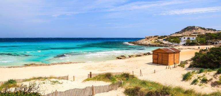 Sand beach house turquoise sea view, Cala Agulla, Majorca island, Spain shutterstock_137054780-2
