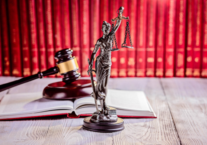 Symbols of law in court library iStock_92233081_XLARGE-2