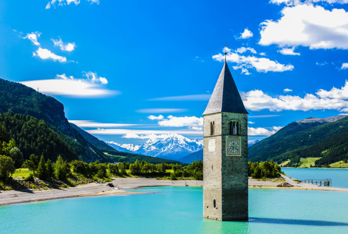 tower of sunken church in Resia lake, South Tyrol, Italy shutterstock_263053031-2