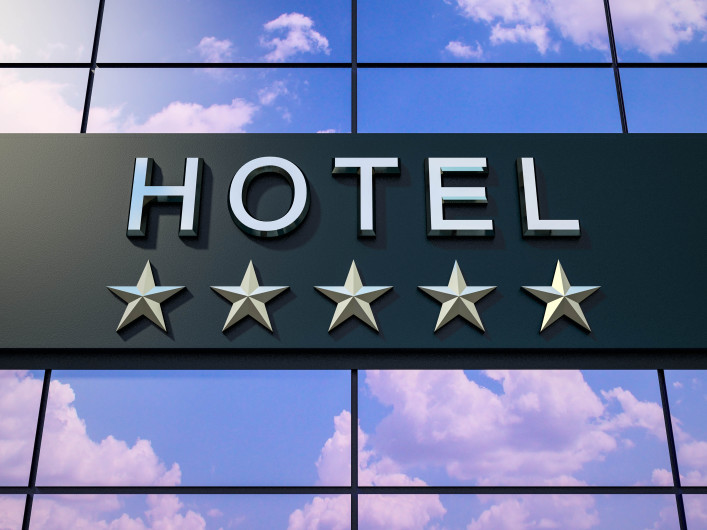 The hotel sign with five stars.
