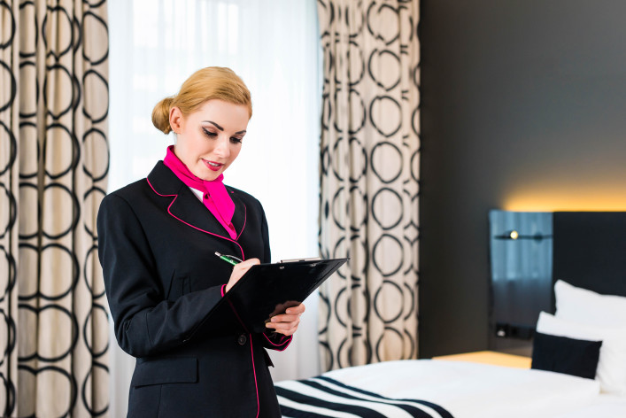 Housekeeper checking hotel room