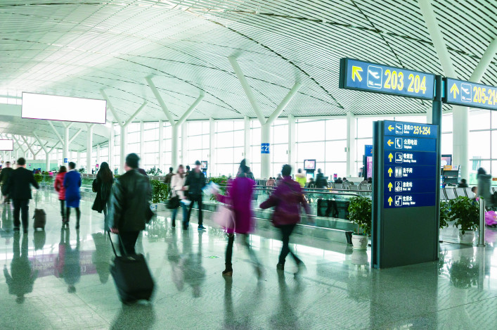 Passengers in Shanghai Pudong International Airport Airport shutterstock_129645623-2