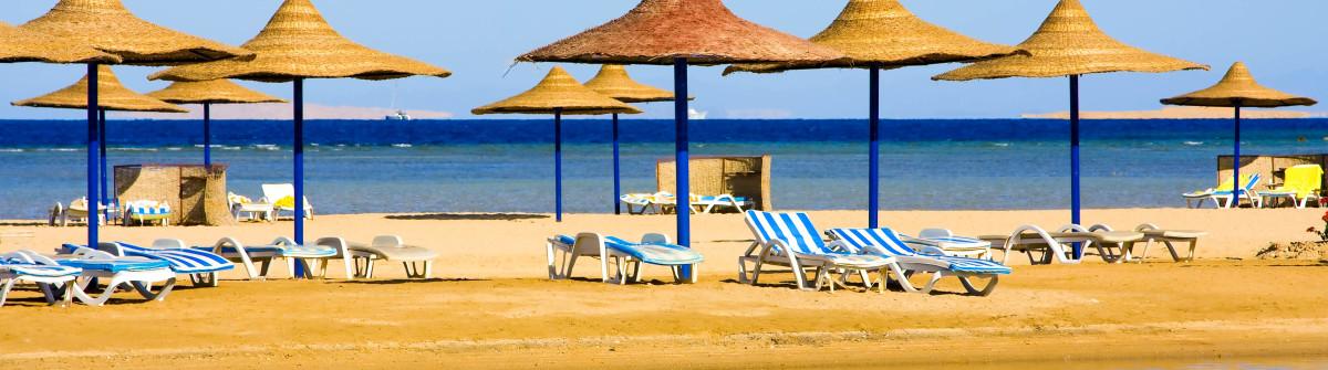 Straw umbrella on the beach, Hurghada  Egypt shutterstock_112595585-2