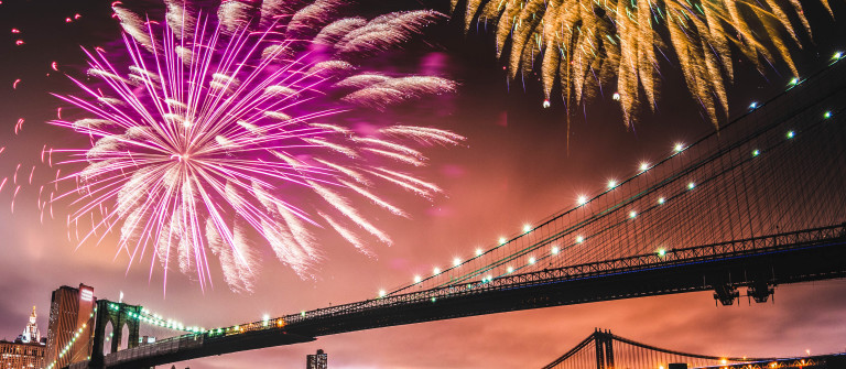 fireworks for a national holiday over the brooklyn bridge