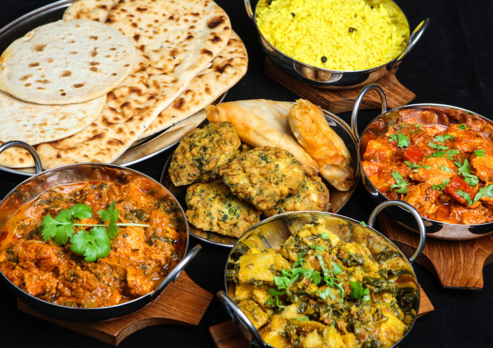 Photo of plates of different types of Indian food