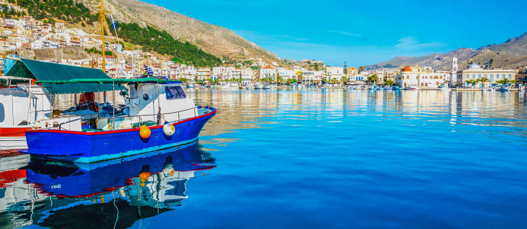Blue wooden boat moored in peaceful port