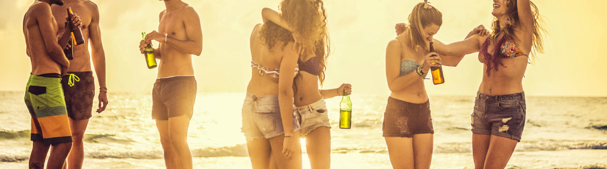 Summer vacations group of friends party on the beach iStock_000083359031_Large-2