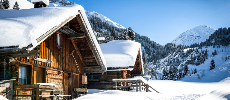 wooden houses on austrian mountains
