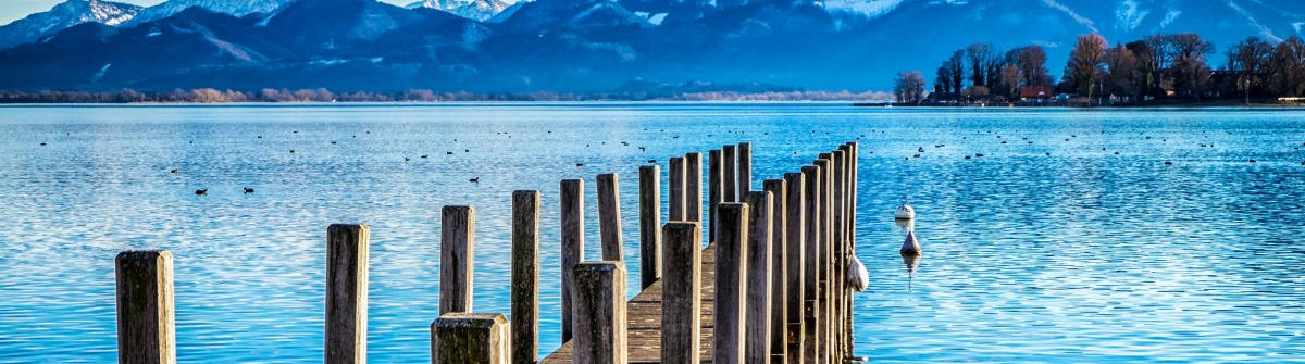 old wooden jetty at the chiemsee lake in bavaria shutterstock_237279748-2
