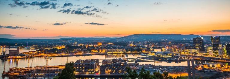 Oslo city lights illuminated under blue chrome dusk sky Norway iStock_000055261494_Large-2
