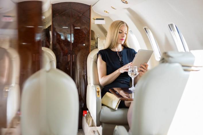 Privat jet woman shutterstock_167757638