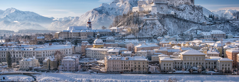 Salzburg with Hohensalzburg covered in Snow, Austrian Alps