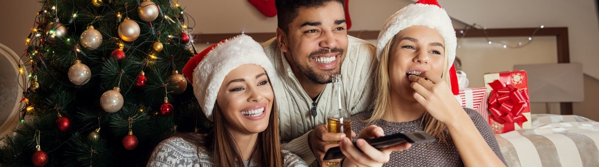 Friends watching movie and having fun at Christmas eve. shutterstock_505139767