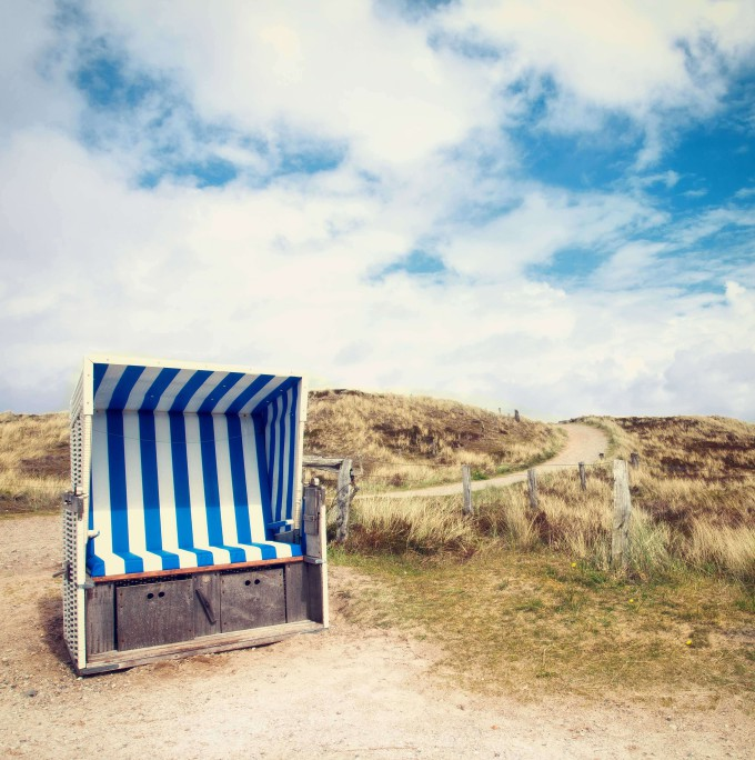 beach chair in sandy dunes at the Island of Sylt, Germany_shutterstock_192858032_klein