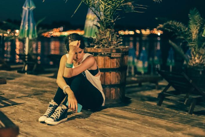 Girl on a wooden veranda near the beach