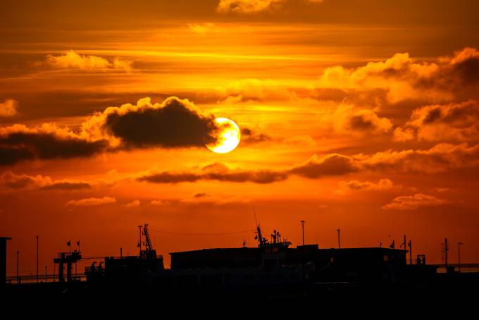 Sunset in Norddeich harbor, Germany_shutterstock_438930301_klein