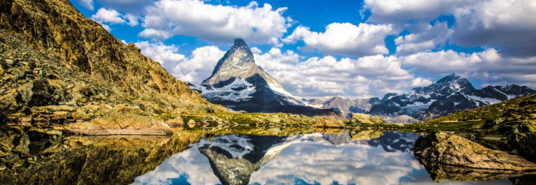 Swiss beauty, Riffelsee lake with Matterhorn mount reflexion shutterstock_299052143-2
