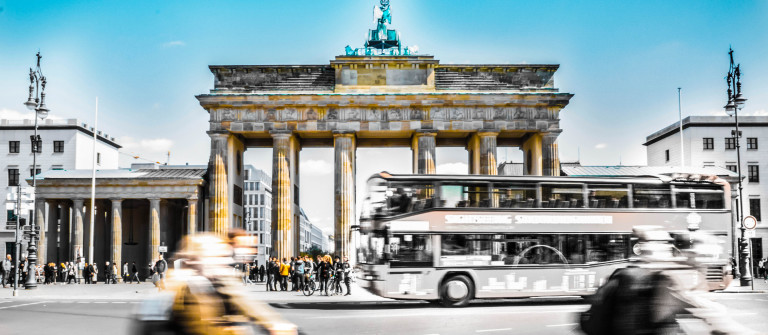 The Brandenburg Gate in the middle of burly city-life