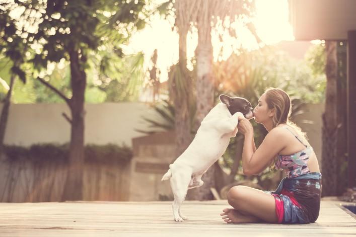 Woman dog kissing_shutterstock_263118074