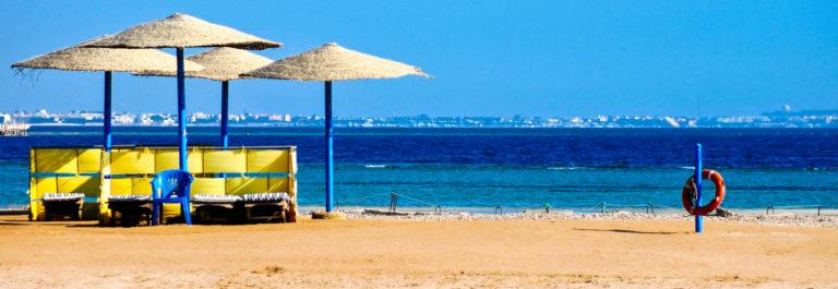Straw umbrellas on the beach of Egypt shutterstock_43973791-2