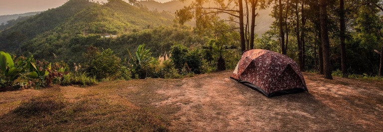 Tents on a hills at sunrise at Taksin Maharach