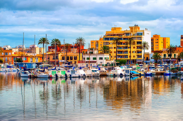 Yachts in front of apartment village in Palma de Mallorca, Majorca, Spain shutterstock_113470273-2