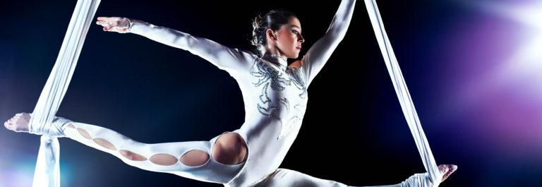 A young female gymnast on silks