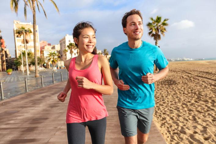 Running couple jogging on Barcelona Beach, Barceloneta shutterstock_195012359-2