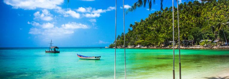Swing hang from coconut tree over beach, Phangan island ,Thailand
