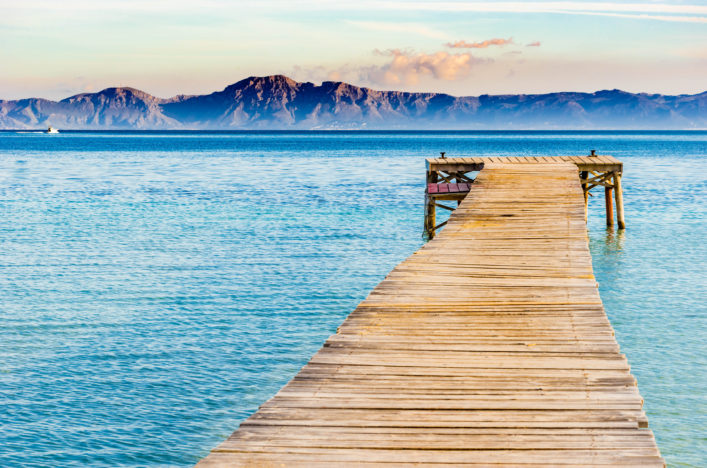 Beautiful scenery with jetty at the seaside of Alcudia beach Platja de Muro, Spain Majorca shutterstock_570312574-2