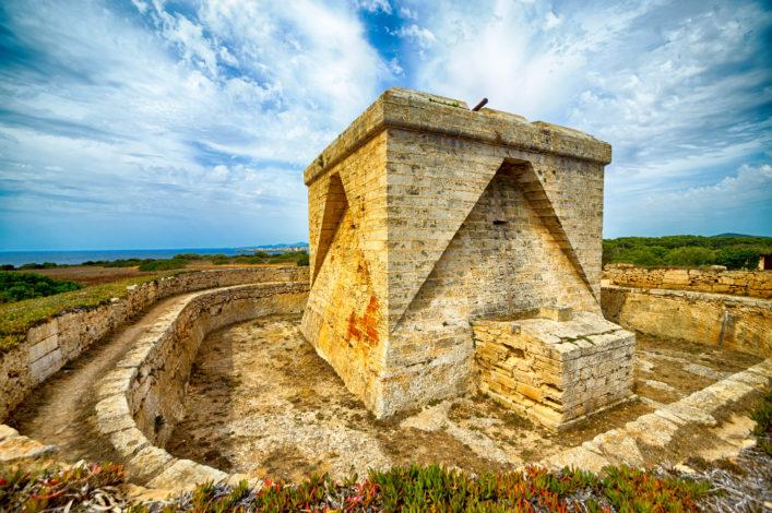Defense tower of Punta de N'Amer at Sa Coma, Mallorca, Spain shutterstock_208739287-2