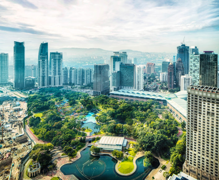 Aerial view of Kuala Lumpur skyline feature the KL city park in the foreground.