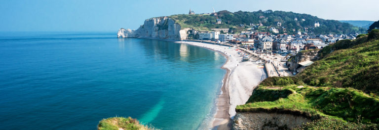 View from the famous white cliffs of Etretat on the beach and the village, Alabaster Coast, Normandy_shutterstock_405245815