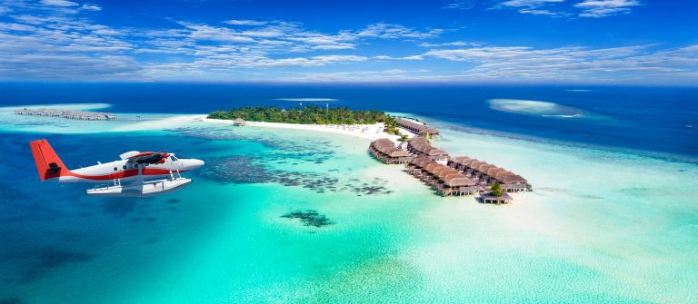 Aerial view of a seaplane approaching island in the Maldives shutterstock_605726798