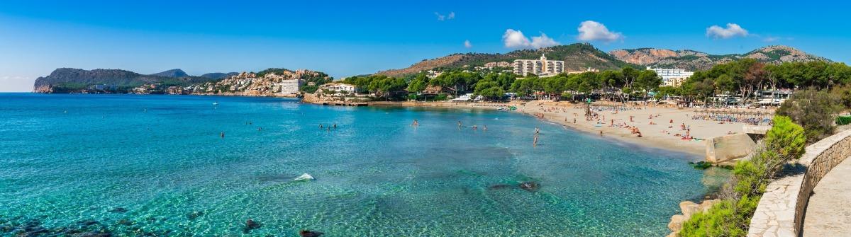 Spain Majorca beach Platja de Tora, panorama seaside of Paguera at Mallorca, mediterranean sea coast. shutterstock_528427720