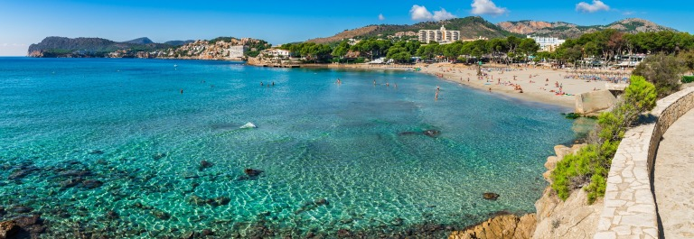 Spain Majorca beach Platja de Tora, panorama seaside of Paguera at Mallorca, mediterranean sea coast. shutterstock_528427720