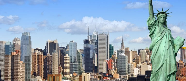 new york city cityscape skyline with statue of liberty shutterstock_339298199