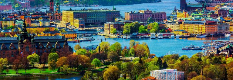 Scenic summer aerial panorama of the Old Town (Gamla Stan) architecture in Stockholm, Sweden_shutterstock_191780339-2_pix2000