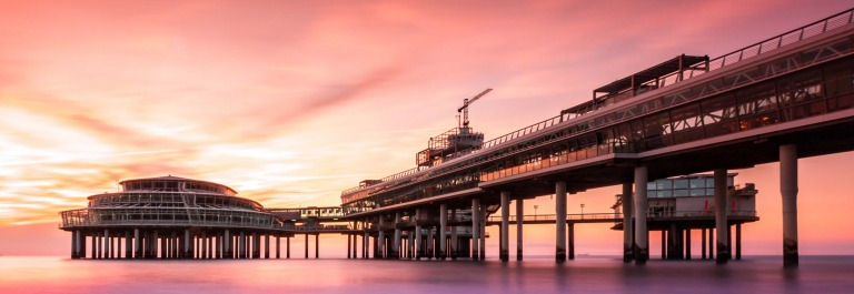 Scheveningen Pier at sunset, in The Hague, The Netherlands shutterstock_326746700-2
