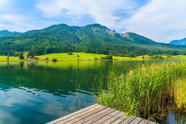 View of beautiful Weissensee lake in summer landscape of Alps Mountains, Austria
